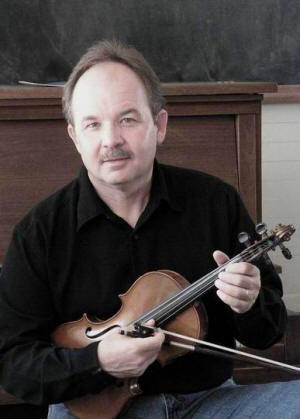 Violinist Tim Crouch is also a virtuoso guitar and mandolin player.