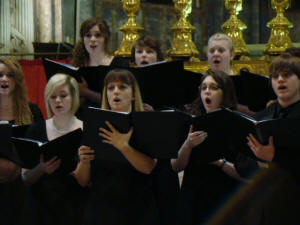 (L-R) Back: Katherine Richards, Jordan Ferris, Sloane Simmons; Front: Hannah McQuay, Madison Kuebler, Megan Bishop, Katie Cole, Kyle Plunkett during a performance at Chiesa di Santa Maria Sopra Minerva in Rome.