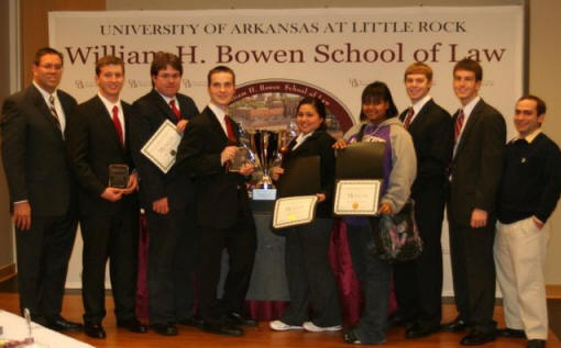 Dr. Hans Hacker, left, team coach, poses with the 2011 Moot Court team.