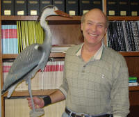 From left, Great Blue Heron decoy and Dr. Jim Bednarz