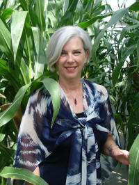 Dr. Elizabeth Hood stands out in her field of corn, essential to her work with cell walls and targeted gene expression in maize, which fuels her work in bioenergy and biomass conversion.