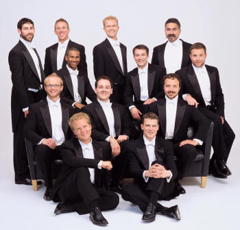 Members of Chanticleer are (standing, from left) Alan Reinhardt, Matthew D. Oltman--music director, Gabriel Lewis-O'Connor, Eric Alatorre. Second row, seated, from left are Michael McNeil, Cortez Mitchell, Gregory Peebles, Brian Hinman, Dylan Hostetter, and Todd Wedge. In foreground, seated, are Jace Wittig and Adam Ward.