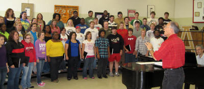 Dr. Dale Miller rehearses with members of ASU choirs.