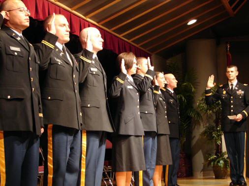 Col. Jeffery Helms, ASU professor of military science, administers the oath to the 2009 ASU graduates and newest second lieutenants in the United States Army (left to right): Patrick Byerly, Troy Cline, Travis Eddleman, Brandi Johnson, Nathan Smith, Megan Watters, and Jeremy Weeks.