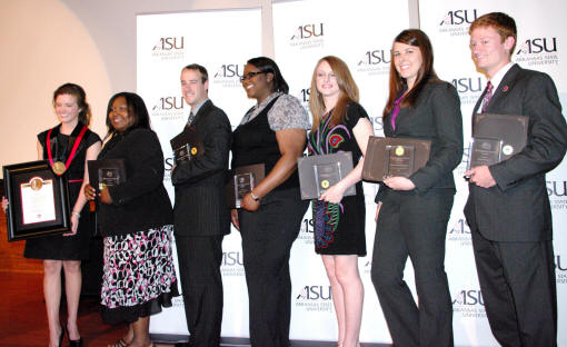 From left, Wilson/Distinguished Service Award winner, Anna Callaway, and Distinguished Service Award winners Jervonne Newsome, Adam Jackson, Sharnea Diggs, Lark Little, Anne Marie Cason, and Ryan Beaird.