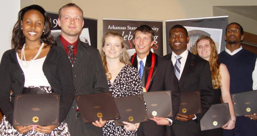 Distinguished Service Award winners are, from left, Yana-Janelle Scott, Kevin Linker, Rachel Caitlin Farris, Kyle Fulton, Quan Poole, Heather Gillion, and Brian C. Flagg.
