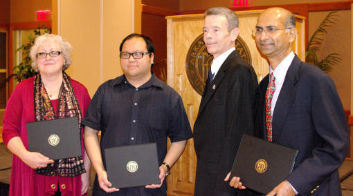 Faculty honorees for professional service, scholarship, and teaching are, from left, Dr. Deborah Persell and Dr. Rollin Tusalem, with Provost G. Daniel Howard and Dr. Sarath Nonis.