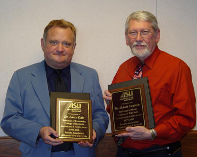 Dr. Larry Dale and Professor Richard Jorgensen hold the plaques presented to them upon retirement from ASU. Dr. Whitney Williams and Dr. William Wyatt were not present.