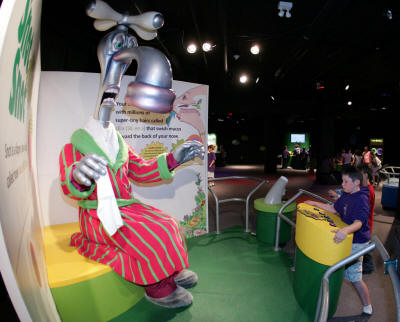"Nigel Nose-It-All, left, is one of the animatronic figures featured in ""Grossology."" Nigel, more than nine feet tall, makes a presentation on the functioning of the nose."