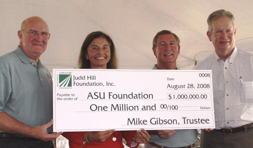 Dr. Les Wyatt, Dr. Susan Hanrahan, Mike Gibson, and Dr. Robert L. Potts display a $1 million check for ASU's Donald W. Reynolds Center for Health Sciences.