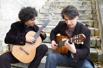 Judicael Perroy, left, and Jérémy Jouve, perform together as Paris Guitar Duet.