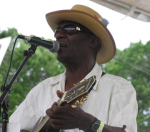 Jimmy 'Duck' Holmes performs at the 2007 Chicago Blues Festival. Photo credit: the Mississippi Folklife and Folk Artist Directory.