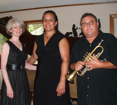 The Ozark Jazz Orchestra (from left) includes pianist Joy Sanford,vocalist Lisa Ahia, and trumpeter Gary Gazaway; violinist Tim Crouch is pictured separately.