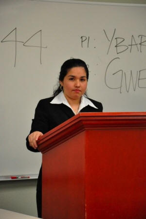 Lilia Pacheco, a sophomore political science and philiosophy major of Jonesboro, addresses the audience at Texas Wesleyan University School of Law.