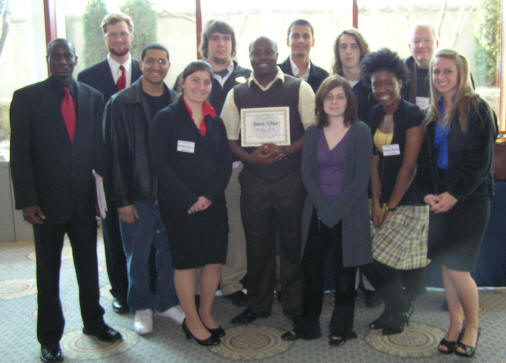 ASU's Model United nations group poses with their award in St. Louis.