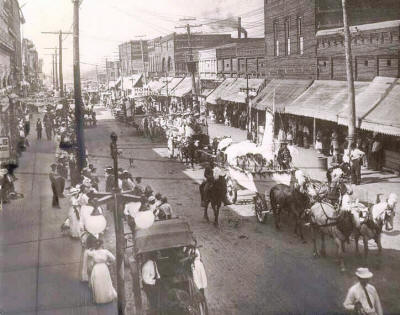 Downtown Jonesboro hosts an earlier parade near the turn of the century.