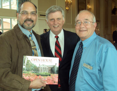 "From left, Pradeep Mishra, Governor Mike Beebe, and Dave Maloch are photographed with a copy of ""Open House--The Arkansas Governor's Mansion and Its Place in Arkansas History,"" produced by ASU Printing Services. Mishra is director and Maloch is associate director of ASU Printing Services."
