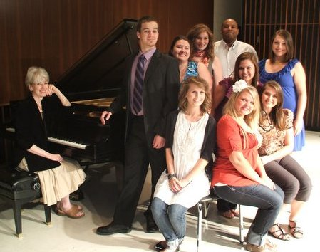 Seated at the piano: Joy Sanford, accompanist for ASU Opera Theatre;back row: Kale McDaniel, Crystal Aronson, Katherine Richards, Craig Young, Becky Morrison;leaning over seated women (middle): Renee Smith; seated on chairs in front: Paige Harris, Erin Reagan, Kari Rickman.