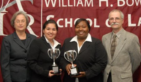 Judge Susan Webber-Wright, Lilia Pacheco, Jervonne Newsome, and Bowen School of Law's Dean John DiPippa pose after the South Central Regional Moot Court Championship Tournament.