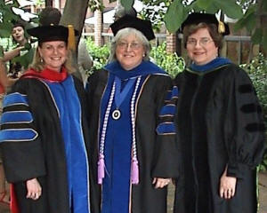 Dr. Elizabeth Young, left, Dr. Debbie Persell, center, and Dr. Susan Speraw, right, gather after Persell's graduation from the new Homeland Security Nursing program at UT-Knoxville.