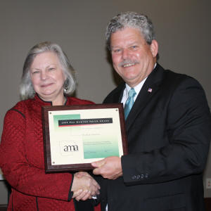 ASU's Dr. Ruth Hawkins accepts the Peg Newton Smith Lifetime Achievement Award from Steve Rucker, president of the Arkansas Museums Association, at its awards banquet on March 25.