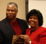 Alumnus Marlon Henderson receives Outstanding Alumni Award from Ruby Henderson of Jonesboro. Photo courtesy Dr. Nancy Hendricks, director, Alumni Communications.