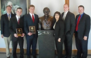 Abram Skarda, second from left, and Daniel Shults, third from left, pose with their plaques after finishing the ASU Moot Court season with wins at Baylor School of Law.