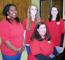 Personnel for singing valentines includes ASU choir members Janet Tullos, seated at the piano, and from left, Suemone Christian, Hannah McQuay, and Katie Matney.