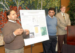 Dr. Shivan Haran (left) and Dr. Ashraf Elsayed explain their project, as Dean Greg Phillips looks on.