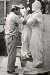 Stone carver Vincent Palumbo puts finishing touches on a statue depicting Saint Peter, destined for the west façade of the Cathedral Church of Saint Peter and Saint Paul, more commonly known as the Washington National Cathedral. Photo by Marjorie Hunt.