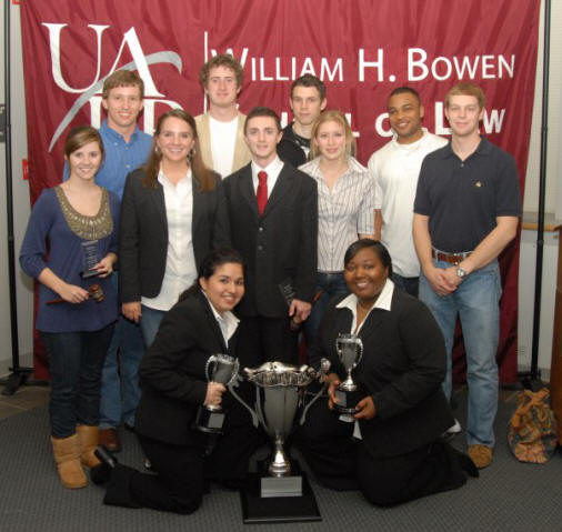 The ASU Moot Court team poses with the Robert R. Wright III championship trophy they won at the South Central Regional Moot Court Championship Tournament.