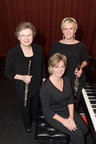 The University Trio of UT-Martin, Dr. Elaine Harriss,  Dr. Amy Simmons (standing, left to right), and Ms. Dana Easley, seated, will perform on Monday, Feb. 9 at 7:30 p.m. in ASU's Riceland Hall, Fowler Center.