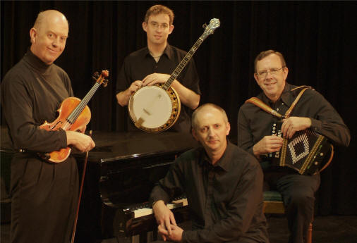 From left, the members of the Brock McGuire band are Manus McGuire, fiddle, Enda Scahill, banjo, and Paul Brock, button accordion, with Denis Carey, piano, seated at his instrument.